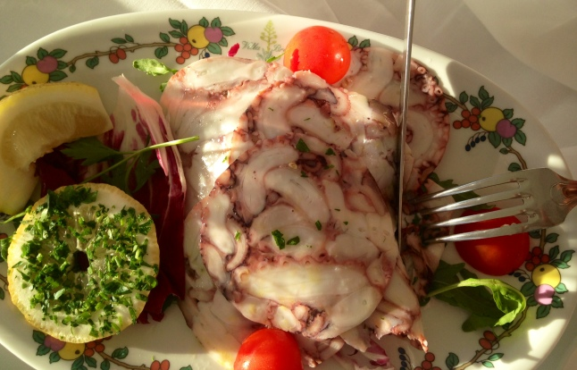 Steamed carpaccio octopus with fresh red salad and rucola